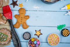 Decorating of gingerbread man Christmas cookie Royalty Free Stock Photos