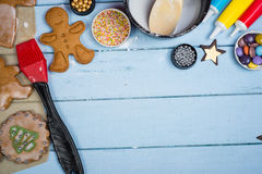 Decorating of gingerbread man Christmas cookie Stock Image