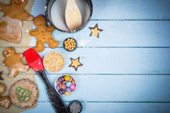 Decorating of gingerbread man Christmas cookie Stock Images