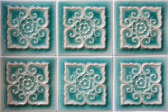 Decorating green ceramic wall tiles Stock Images