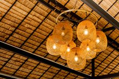 Decorating hanging lantern lamps in wooden wicker made from bamboo. Interior decoration royalty free stock photography
