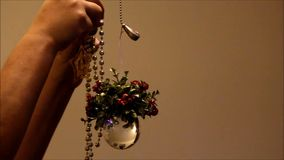 Mixed christmas ornaments hung up stock video footage
