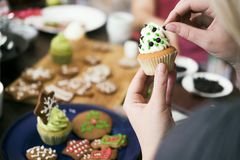 Decorating homemade cupcake for christmas Royalty Free Stock Images