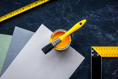 Decorating and house renovation tools and accessories on black stone table background top view mockup. Decorating and house renovation tools and accessories on stock image