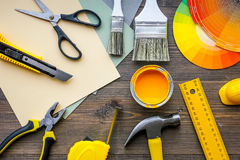 Decorating and house renovation tools and accessories on wooden table background top view Stock Image