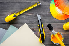 Decorating and house renovation tools and accessories on wooden table background top view mockup Stock Photos
