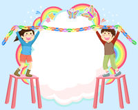Decorating kids. Kids hanging colorful decorations on abstract background Stock Photo