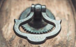Metal Door Handle Knocker On Wooden Door stock images