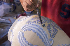 Decorating a Mexican clay vase Stock Photography