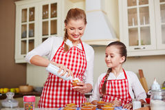 Decorating muffins Royalty Free Stock Photo
