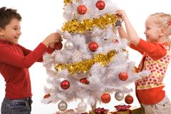 Decorating New Year tree Royalty Free Stock Photography