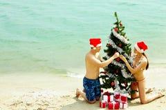 Decorating New Year tree Stock Photos