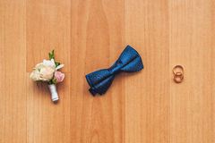 Decorating the newlyweds. Butterfly, flowers and rings lie on the floor Stock Photography
