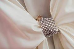 Decorating the newlyweds. Wedding rings lie on rhinestones Stock Image