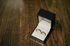Decorating the newlyweds. Wedding rings for the wedding are in a box Royalty Free Stock Image