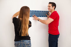 Decorating our home together Stock Photos