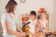 Decorating pumpkins Royalty Free Stock Images