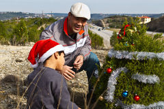 Decorating a roadside Christmas tree Stock Images