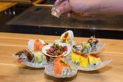 Decorating sushi Royalty Free Stock Images