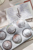 Decorating sweet muffins with caster sugar Royalty Free Stock Photos