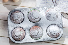 Decorating sweet muffins with caster sugar Stock Photo