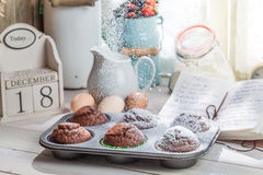 Decorating tasty cupcakes with caster sugar Stock Photo