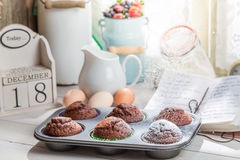Decorating tasty cupcakes with caster sugar Stock Photography