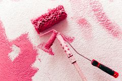 Decorating tools. Paint roller and brush to lean against a wall royalty free stock photos