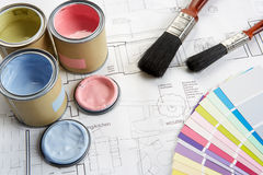 Decorating tools and materials. On top of blue prints royalty free stock image