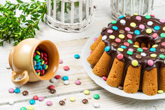 Decorating traditional easter cake with candies Royalty Free Stock Photo