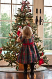 Decorating The Tree. Little Girl Decorating A Christmas Tree Stock Photography