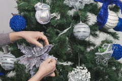 Decorating the tree for Christmas Stock Photography