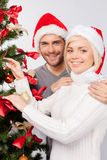 Decorating tree for Christmas. Stock Image
