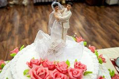 Decorating a wedding cake. Stock Photos