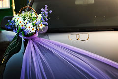 Decorating wedding car basket  flowers. Royalty Free Stock Images