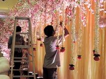 Decorating wedding reception hall at  traditional Hindu wedding, India Royalty Free Stock Photography