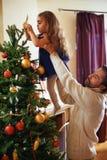 Decorating xmas tree Stock Images