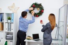 Decorating xmas wreath Stock Photo