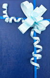 Decoration. Isolated blue gift with bow Royalty Free Stock Photo