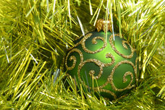 Decoration. Green decoration ball in tinsel Royalty Free Stock Image