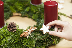 Decoration an Advent wreath. Decorate an advent wreath with a cinnamon star royalty free stock photography