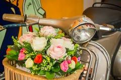 Decoration artificial flower in basket on motorbike Stock Photo