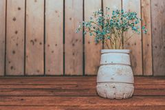 Wildflowers on wooden table with wooden background. royalty free stock photo