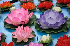 A decoration of artificial lotus flowers. A photo taken on some decoration display of artificial lotus flowers in different colors royalty free stock photo