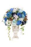 Decoration artificial plastic flower with vintage design vase Stock Photos