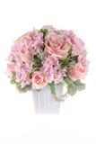 Decoration artificial plastic flower with vintage design vase Royalty Free Stock Images