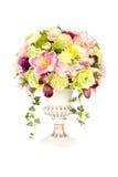 Decoration artificial plastic flower with vintage design vase Royalty Free Stock Image