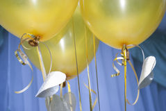 Decoration balloons on holiday. Decoration yellow balloons on holiday Stock Image