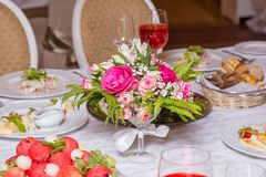 Decoration of banquet - flowers on table Stock Photos