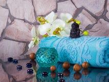 Decoration of  bathhouse with buddha, nuts, touwel and candlesti Royalty Free Stock Photo